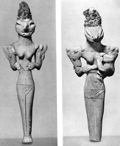 reptilian figurines two